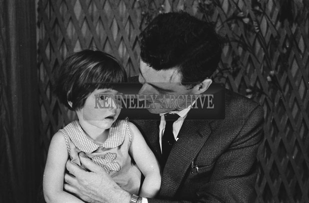 1953; A Studio Photo Of A Young Girl With Her Father.