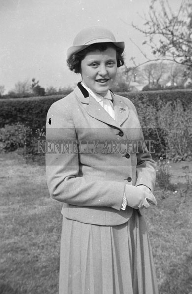 May 1957; A girl poses for the camera on her confirmation day in Ballylongford.