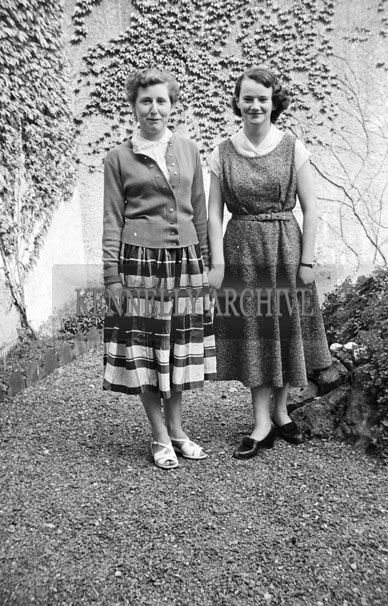 May 1957; A confirmation girl and her mother pose for the camera in Ballylongford.
