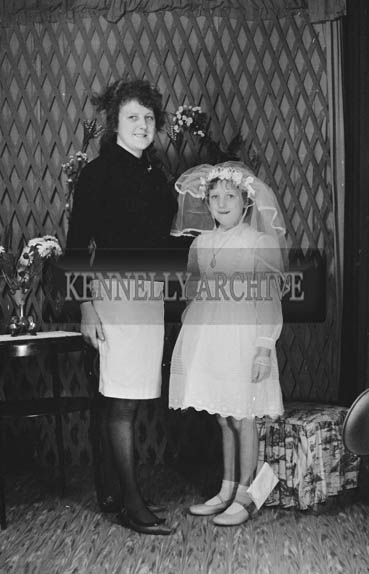 27th June 1964; A Girl and Her Mother Posing For The Camera on Her Communion Day.
