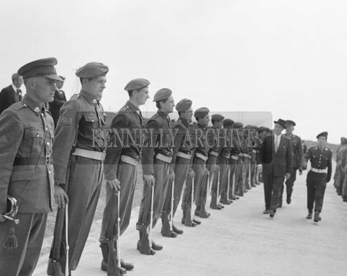 25th May 1964; The official opening of the Kerry Precision Ball Bearing Company in Tralee, attended by the Minister for Industry and Commerce Mr Jack Lynch. The Minister is inspecting a guard of honour of the FCA on his arrival at the factory. Lieutenant Gerald Landers is on the right.