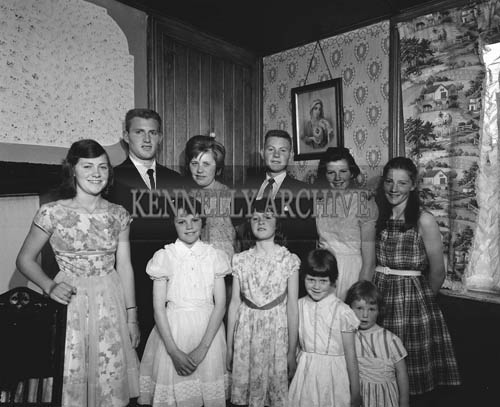 July 1964; A group photo of a family, taken in their home.