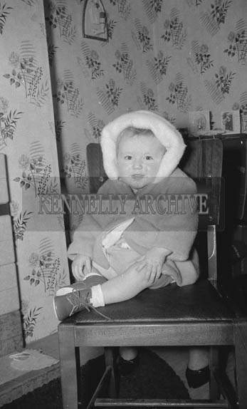 January 1964; A photo of a baby at a first birthday party.