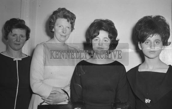 January 1964; A photo of a group of people at a social.