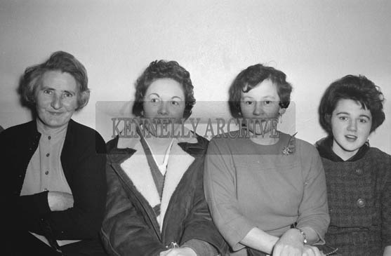 January 1964; A photo of a group of women at a social.