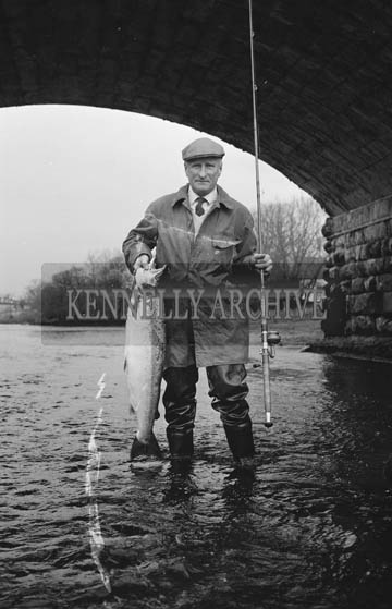 January 1964; A photo of a man with a salmon.
