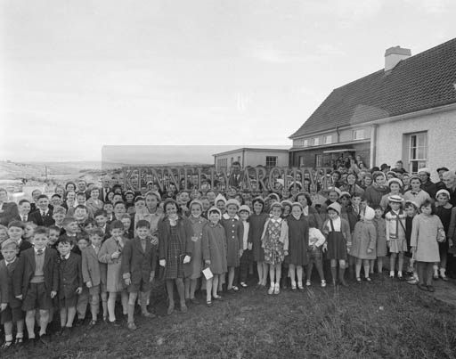 26th October 1964; A photo taken at the opening of Lyre National School, Milltown. The new school was built to accomodate 120 pupils and 3 teachers and replaced the old school that was built in 1911. The blessing ceremony was performed by the very Rev. Fr. T. O'Sullivan, P.P. Duagh.