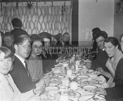December 1964; People enjoying themselves at the Fenit GAA Club Oyster Ball in Godley's Hotel.