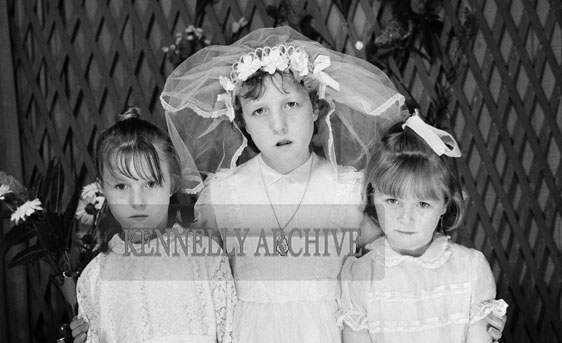 27th June 1964; A Girl and Her Sisters Posing For The Camera on Her Communion Day.