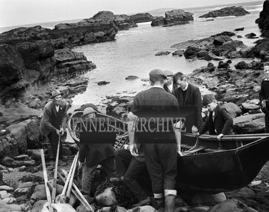 29th June 1964; A photo taken at Kerry Head where 26 year old Pat O'Connor of Meenogohane Causeway and Sargeant William McCarthy of Ballyheigue came to the rescue with a twenty foot canoe of two Dublin Merchant Seamen. The Dublin men, James Whelan and John Tyrell, had to abandon a disabled fishing vessel they had been ferrying from Kilronan, Aran to Dingle when the engine failed off Loop Head on Sunday evening. The boat drifted all night and though the men lighted tyres, threw up flares and hoisted a distress flag, nobody went to their assistance. When the boat struck the rocks at Bird's Island, the men put on life jackets and drifted for over two hours in the rough seas until picked up. By then John Tyrell was unconscious. He received artificial respiration but he died without regaining consciousness. The jury at the inquest returned a verdict of asphixia due to drowning as the cause of death.