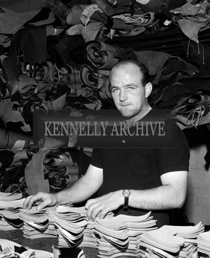 September 1964; A photo of Kerry footballer Teddy Dowd at work in Traly Footware in Tralee.