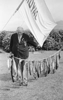 1953; A Photo Of A Man Posing For The Camera With A Line Of Fish On Valentia Island.