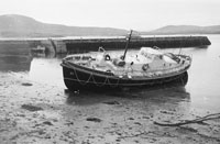 1953; A Photo Of A Boat In The Mud At Valentia Pier.