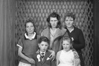 Studio Photo Of A Communion Boy And Family