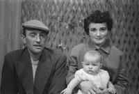 1953; A Studio Photo Of A Family.