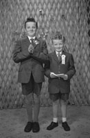Studio Photo Of A Confirmation Boy And A Communion Boy.