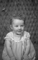 1953; A Studio Photo Of A Baby Girl.