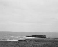 29th June 1964; A photo taken at Kerryhead where 26 year old Pat O'Connor of Meenogohane Causeway and Sargeant William McCarthy of Ballyheigue came to the rescue, with a twenty foot canoe, of two Dublin Merchant Seamen. The Dublin men, James Whelan and John Tyrell, had to abandon a disabled fishing vessel they had been ferrying from Kilronan, Aran, to Dingle when the engine failed off Loophead on Sunday evening. The boat drifted all night and though the men lighted tyres, threw up flares and hoisted a distress flag, nobody went to their assistance. When the boat struck the rocks at Bird's Island, the men put on life jackets and drifted for over two hours in the rough seas until picked up. By then John Tyrell was unconscious. He received artificial respiration but he died without regaining consciousness. The jury at the inquest returned a verdict of asphixia due to drowning as the cause of death.