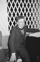 16th January 1964; A young man smiles for the camera at the Lixnaw Social in the Meadowlands Hotel, Tralee.