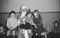 December 1964: A photo taken with Santa at the Eileen Laide Dancing School.