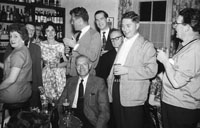 1953; Eamonn Andrews and Grainne Andrews (centre) with A group of people in the Bar of the Royal Hotel Valentia.