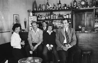 1953; A Photo Of A Group Of People In The Bar Of The Royal Hotel On Valentia Island.