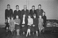 December 1953; A group of people posing indoors.