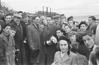 26th-28th December 1953; A Group Of People With The Owner Of The Winning Greyhound Holding The Trophy At The Kingdom Cup Coursing Meeting At Ballybeggan Park, Tralee.