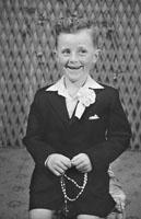 1953; A Studio Photo Of A Communion Boy.