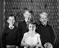 1953; A Studio Photo Of A Communion Boy And Family.