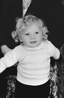 1953; A Studio Photo Of A Young Child.