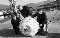 January 1964; A mine found in fishing nets on board John Brosnan's boat, Ard Ide. The mine was cordoned off by gardaí and brought back to shore. Apparently the mine was used by French fishermen as a bouy. The spikes had been sawn off, so the mine was harmless.